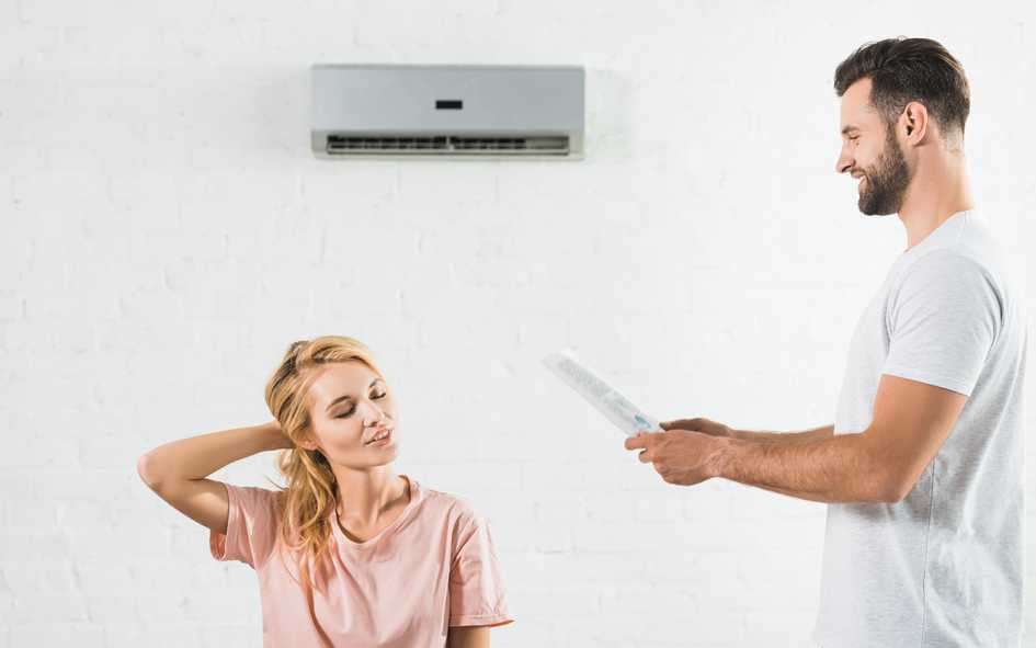 Couple with Air Conditioner